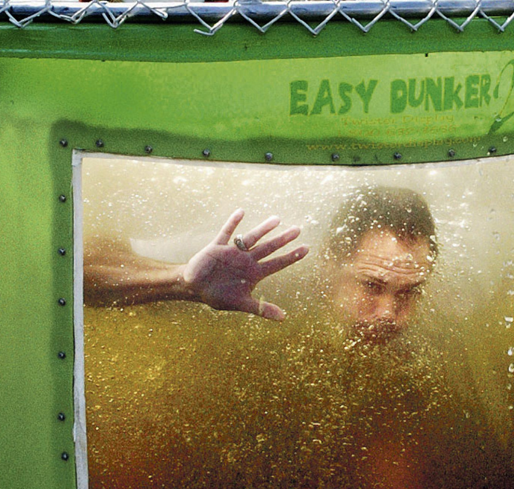 State Rep. Brad Farrin looks out from a dunk tank after volunteering for the Norridgewock Fire Department's fundraiser during Oosoola Days festivities on Monday.