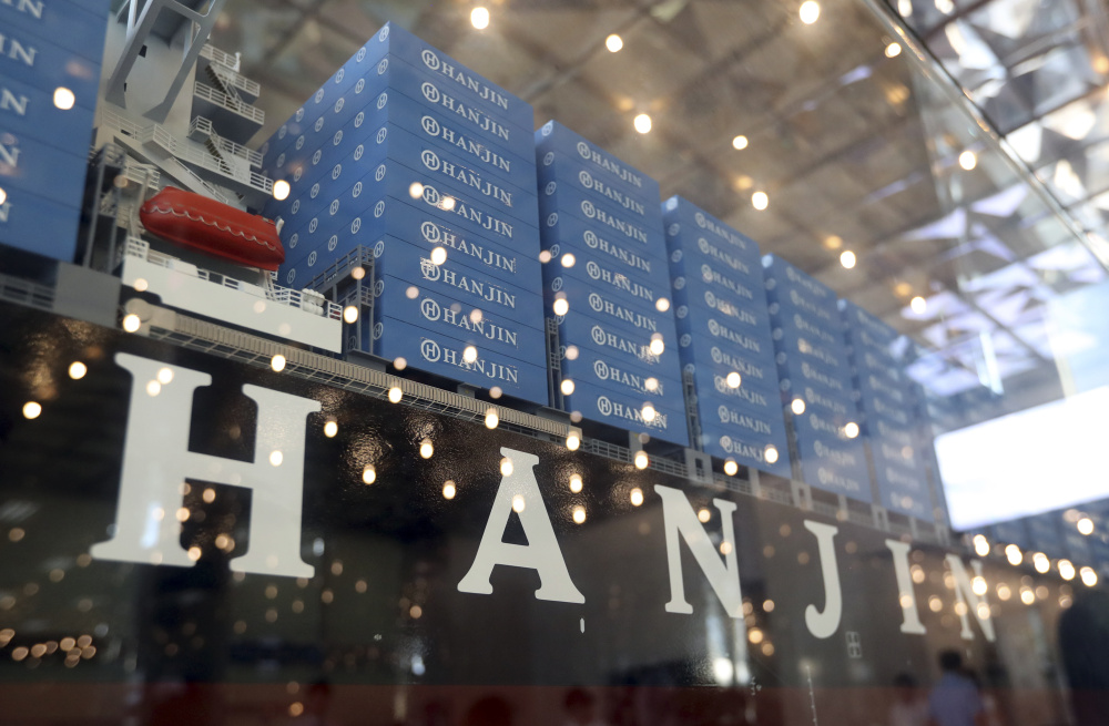A model of a container ship with Hanjin Shipping Co's logo is displayed at its head office in Seoul, South Korea.