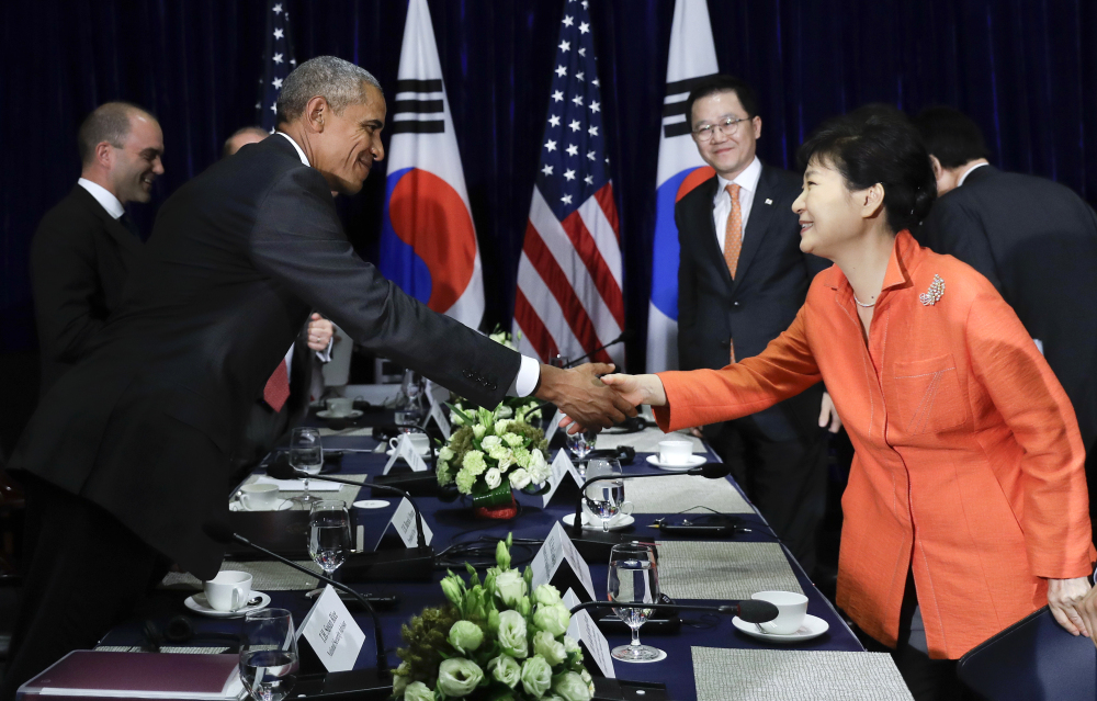 President Obama, left, and South Korean President Park Geun-hye shake hands after speaking to the media at the conclusion of a bilateral meeting in Vientiane, Laos.
