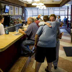 April Pickering, foreground, a cook at the Howard Johnson's in Bangor, hugs longtime patron Fran Kelly of Veazie as the restaurant celebrated its final day of operation Tuesday. The New England-based chain was founded in 1925.