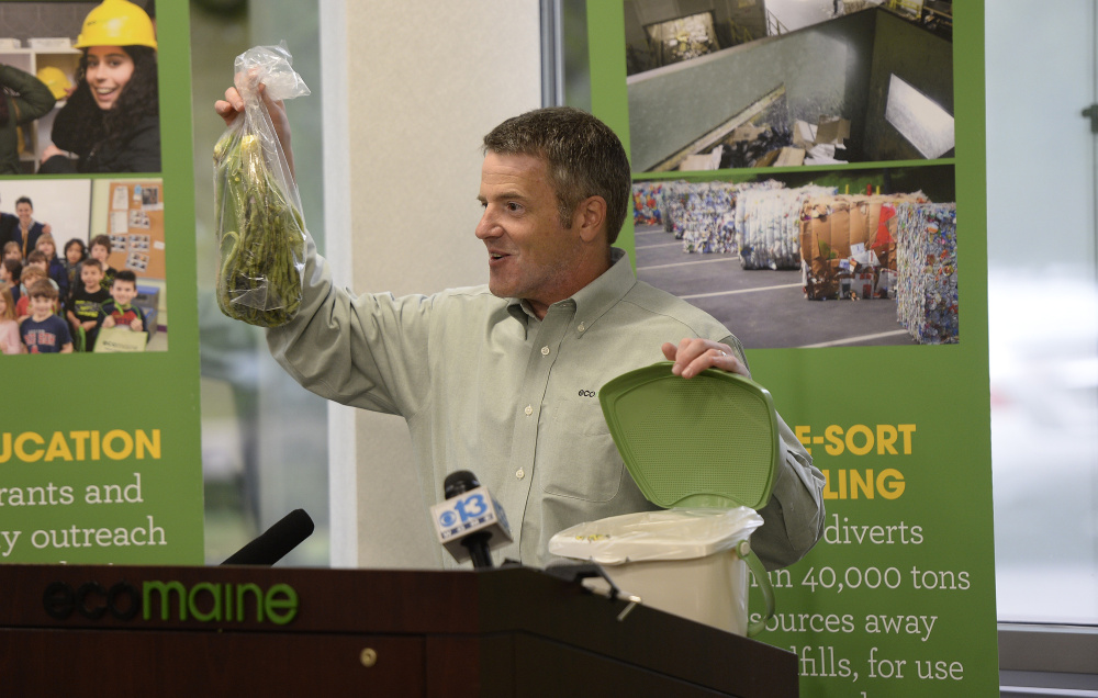 Ecomaine CEO Kevin Roche demonstrates how the food waste program will work at the source. The program will open the door for cities and towns to offer food waste collection.