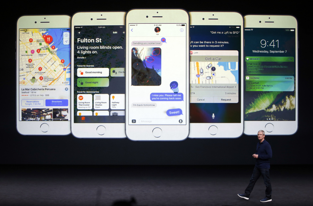 Apple Inc. CEO Tim Cook discusses features of the new iPhone 7 and 7 Plus at a media presentation Wednesday in San Francisco. Apple is betting its loyal fans will embrace the shift to digital headsets that use wireless connections.