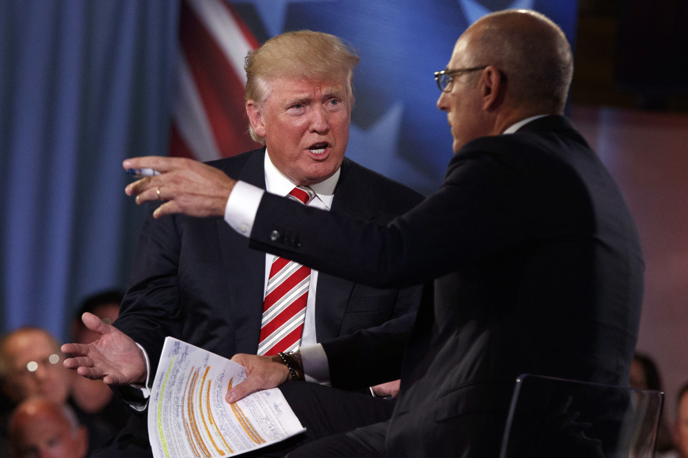 Donald Trump speaks with Matt Lauer during Wednesday night's NBC forum in New York. He said he privately has a plan for defeating the Islamic State but would not disclose the details