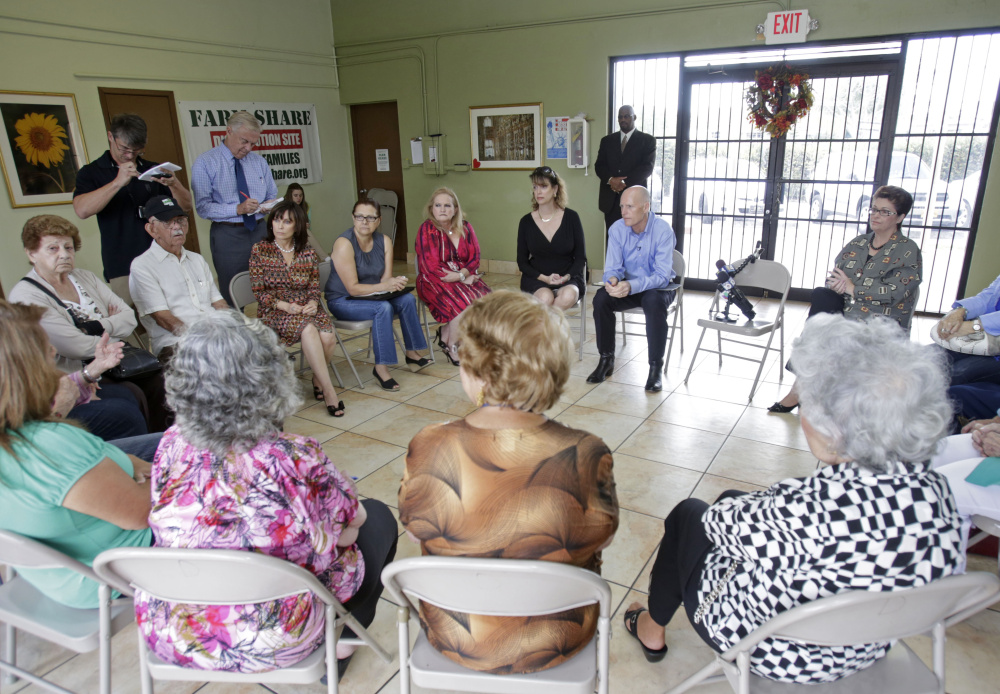 A group of senior citizens meets to discuss health care issues and insurance at the Senior Center in Miami last year. Specialists on aging are examining whether improving seniors home lives can reduce the need to go into a nursing home.