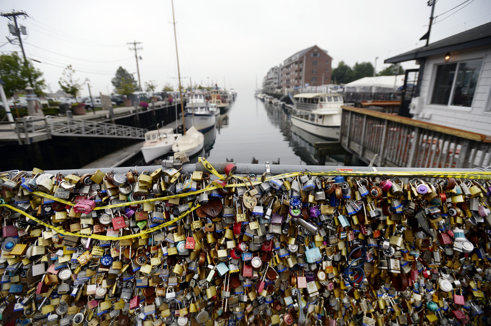 The Love Locks fence in Portland is weighed down with expressions of love and loyalty Thursday. After it's removed, a large portion of the fence, with the locks intact, will be displayed in a nearby parking lot.