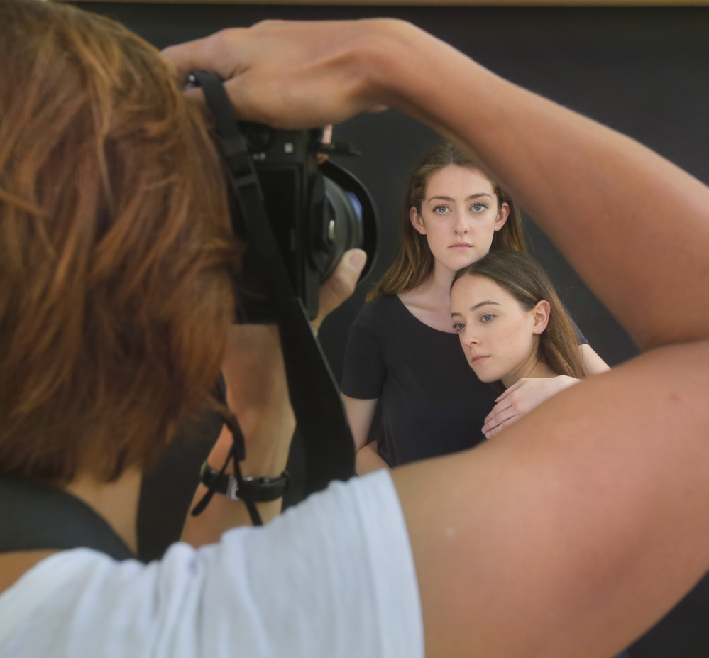 Models Kiera McDonnell, top, and Bailey Dale pose for Sasha Laurita in Camden. Laurita was a student in a Maine Media Workshops portraiture class taught by Joyce Tenneson.