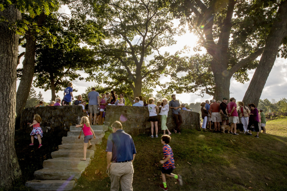 Celebrants gather around the Council Ring, a former bandstand built by the Civilian Conservation Corps, during the grand opening of the new Children's Garden at Fort Williams Park on Cape Elizabeth on Friday, Sept. 9, 2016.