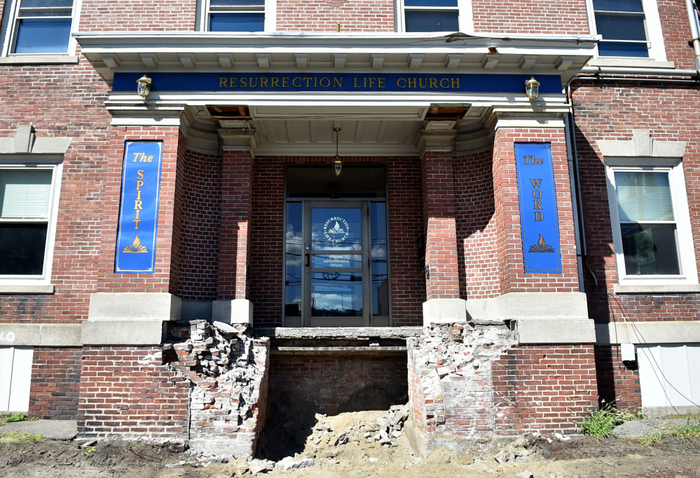 The front brick-and-mortar steps of the former Elk's Lodge on Appleton Street in Waterville have been removed in preparation for tearing the building down.