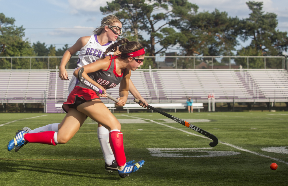 Amelia Papi, who finished with a goal and an assist for South Portland, races for the field hockey ball with Mackenzie O'Donnell of Deering during South Portland's 5-0 victory Friday at Deering High.