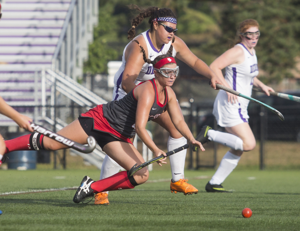 Lydia Henderson of South Portland heads to the ground while going for the ball against Deering. Henderson finished with a goal and an assist as the Red Riots won the first time this season. The Rams are 0-4.