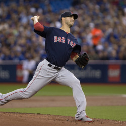 Boston Red Sox starting pitcher Rick Porcello delivers a pitch in the first inning against the Blue Jays in Toronto on Friday.