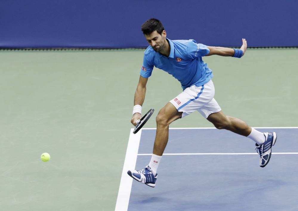 Novak Djokovic fails to catch up with a shot from Stan Wawrinka at  the U.S. Open on Sunday in New York.