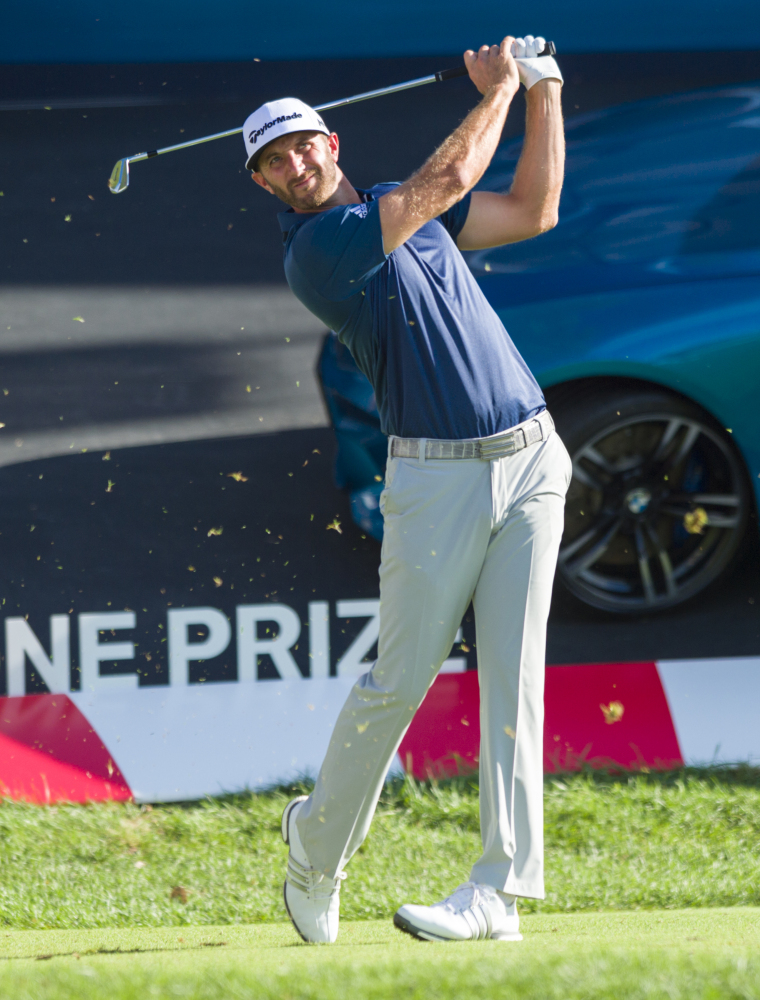 Dustin Johnson tees off from the 17th tee box during the final round of the BMW Championship golf tournament at Crooked Stick Golf Club in Carmel, Ind., Sunday, Sept. 11, 2016. Johnson won the tournament. (AP Photo/Doug McSchooler)