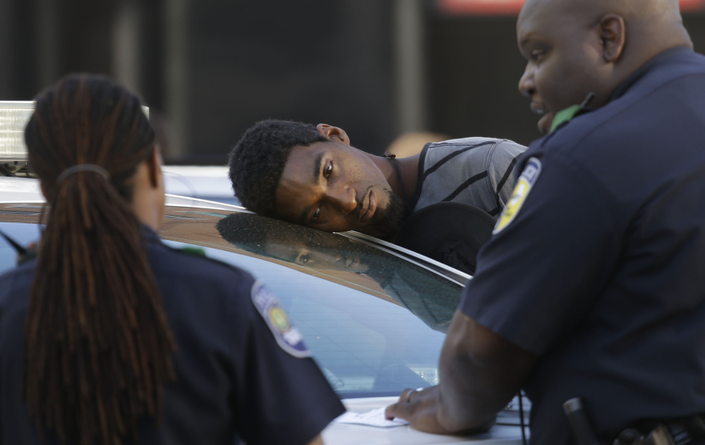 An unresponsive man who police said had smoked spice rests his head on a cruiser in Dallas this month. By 2014, all 50 states had adopted some sort of ban on synthetic drugs such as spice, but those laws are hard to enforce.  Associated Press/LM Otero