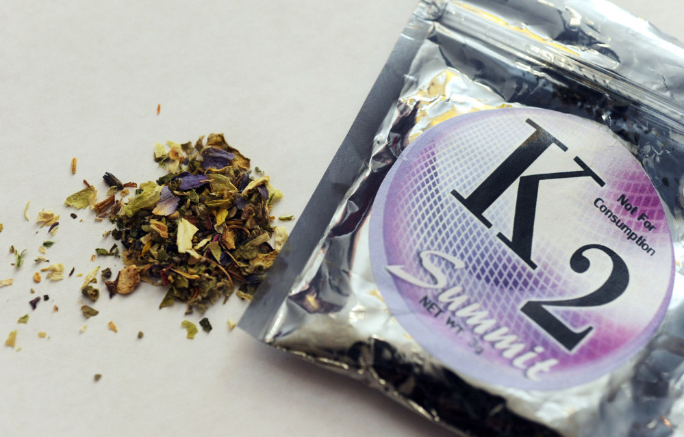 A package holds K2, or spice, which is made by spraying psychoactive chemicals onto plant matter. Enforcing bans on the drug is difficult because its composition keeps changing.