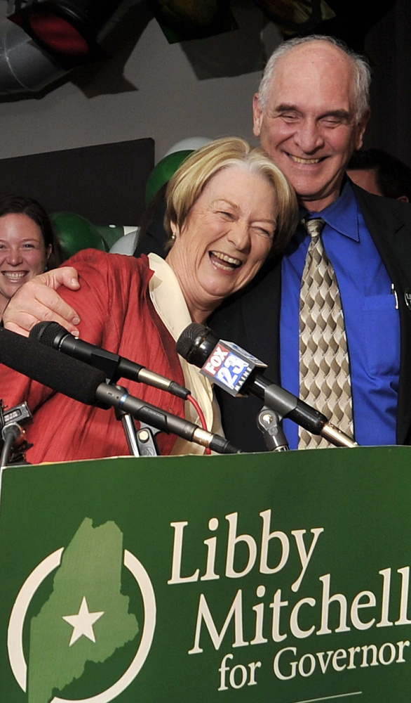 Libby Mitchell gets a hug from her husband, Jim, at her election night gathering in 2010 in Portland. Jim Mitchell was a judge of probate for 37 years in Kennebec County.
