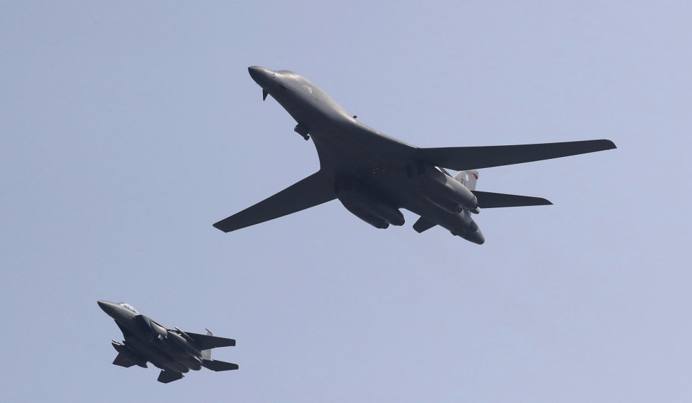 U.S. B-1 bomber, center,  flies over Osan Air Base with South Korean Air Forces jet in Pyeongtaek, South Korea, Tuesday. The United States has flown nuclear-capable supersonic bombers over ally South Korea in a show of force meant to cow North Korea after its fifth nuclear test and also to settle rattled nerves in the South.