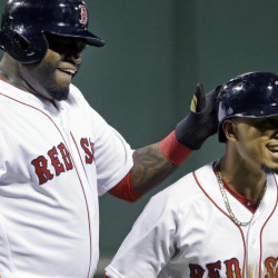 Red Sox's David Ortiz, left, celebrates with Mookie Betts after they scored on a single by Hanley Ramirez in the first inning against the Baltimore Orioles on Monday in Boston.