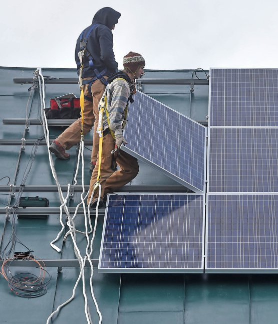 The financial incentive that helps small generators pay for rooftop solar installations like this one is under fire in Maine.