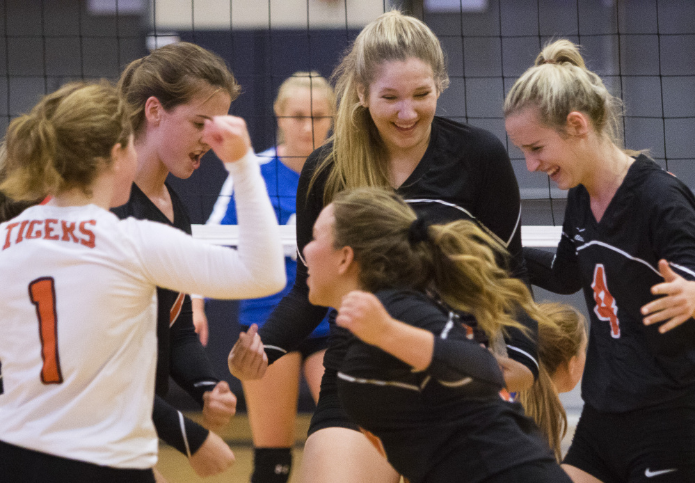 SEPT. 13: Biddeford players celebrate during their Class A volleyball match against Falmouth. The Tigers won in straight sets to improve to 3-1 and hand top-ranked Falmouth its first loss of the season.