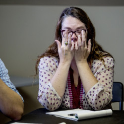 Tears flow as Sarah Rawlings of the Yes on 3 campaign listens to Erica Smegielski, the daughter of the Sandy Hook school principal killed by a gunman in 2012 along with 20 students. Smegielski's visit is one sign of the national focus on Maine's gun sales vote.