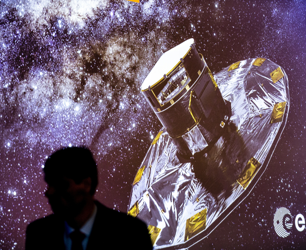 A man walks in front of a slide show depicting the Gaia Mission on Wednesday at the European Space Agency center in Villanueva de la Canada, near Madrid, Spain.