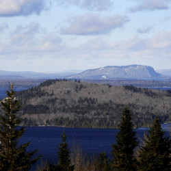 The iconic Mt. Kineo rises above Moosehead Lake in central Maine. Opponents say a wind turbine farm in the area would spoil views and discourage tourism in an area that's trying to become a world-class recreation destination.