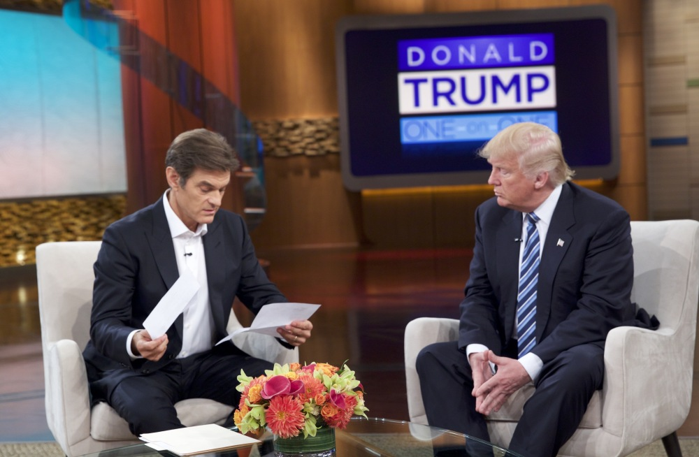 "Dr. Mehmet Oz and Republican presidential nominee Donald Trump tape ""The Dr. Oz Show,"" which airs Thursday. ""I have it right here. Should I do it? I don't care. Should I do it?"" Trump asked before handing Oz the results of his physical exam."