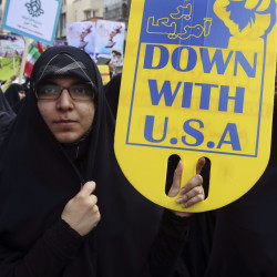 An Iranian demonstrator holds an anti-U.S. placard during an annual rally in front of the former U.S. Embassy in Tehran.