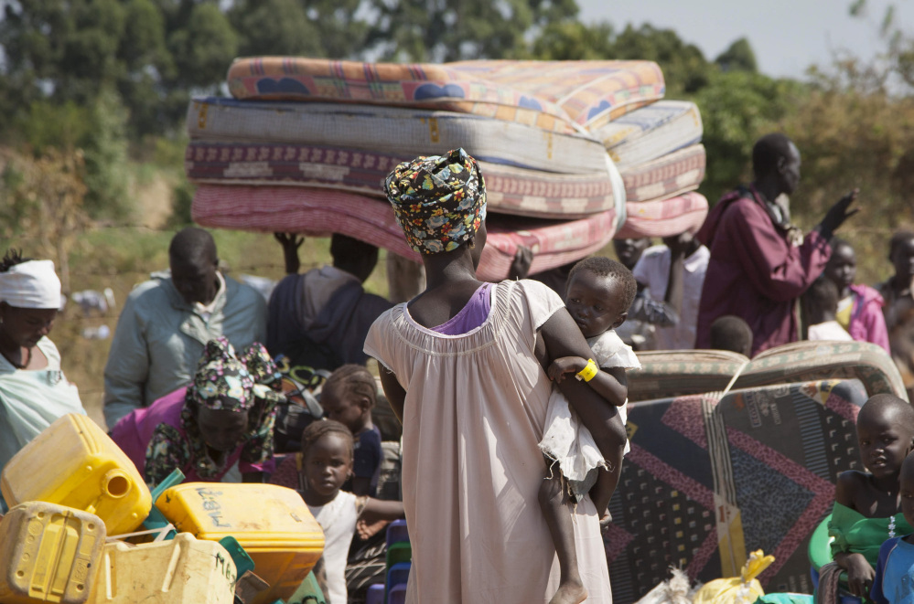 South Sudan refugees await transportation in neighboring Uganda, which hosts the highest number of refugees.