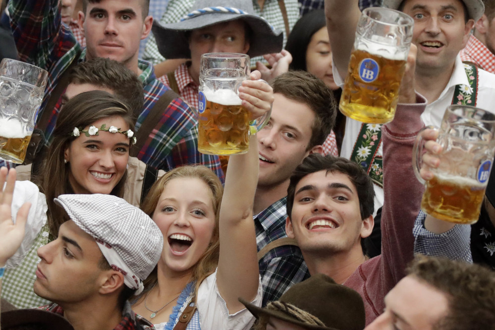 Young people celebrate the opening of the 183rd Oktoberfest beer festival in Munich on Saturday. Security was tight at the world's largest beer festival, which will is being held from Sept. 17 to Oct. 3.