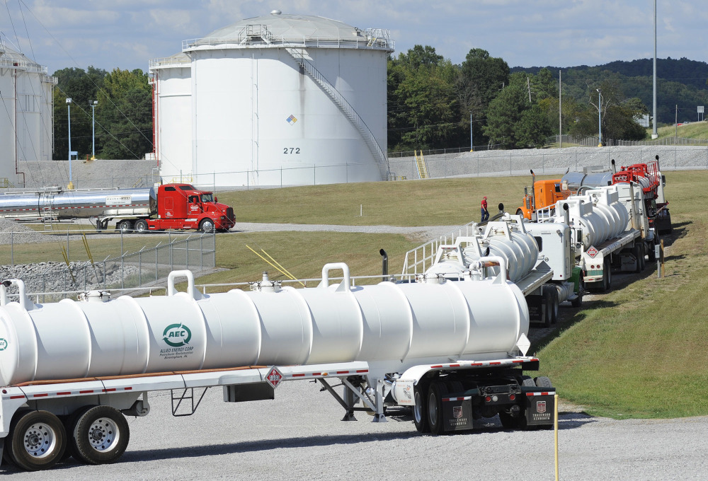 Tanker trucks line up at a Colonial Pipeline Co. facility in Pelham, Ala., near the scene of a 250,000-gallon gasoline spill on Friday, Sept. 16, 2016. The company says spilled gasoline is being taken to the storage facility for storage. Some motorists could pay a little more for gasoline in coming days because of delivery delays.