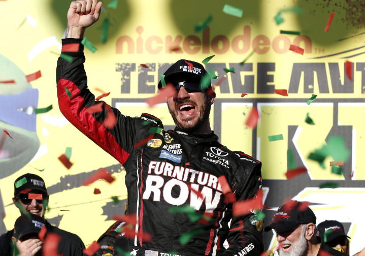 Martin Truex Jr. celebrates with his crew after his victory Sunday at Chicagoland Speedway in the first race of the Chase for the Sprint Cup playoffs.