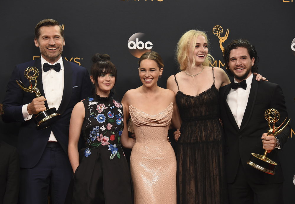 Nikolaj Coster-Waldau, from left, Maisie Williams, Emilia Clarke, Sophie Turner, and Kit Harington – winners of the award for outstanding drama series for
