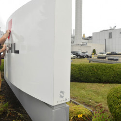 On Monday, workers begin removing the Fairchild Semiconductor name and logo in South Portland and prepare to install a temporary banner with the name of the new owner, ON Semiconductor.