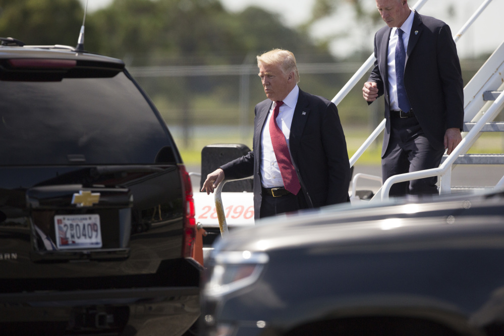 Republican presidential candidate Donald Trump steps off his plane after arriving for a campaign rally at Germain Arena on Monday in Ft. Myers, Fla.