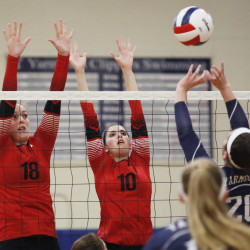 Jordyn Cowan, left, and Jillian Harvie of Scarborough try to block a shot by Rachel Chille of Yarmouth during Scarborough's victory.