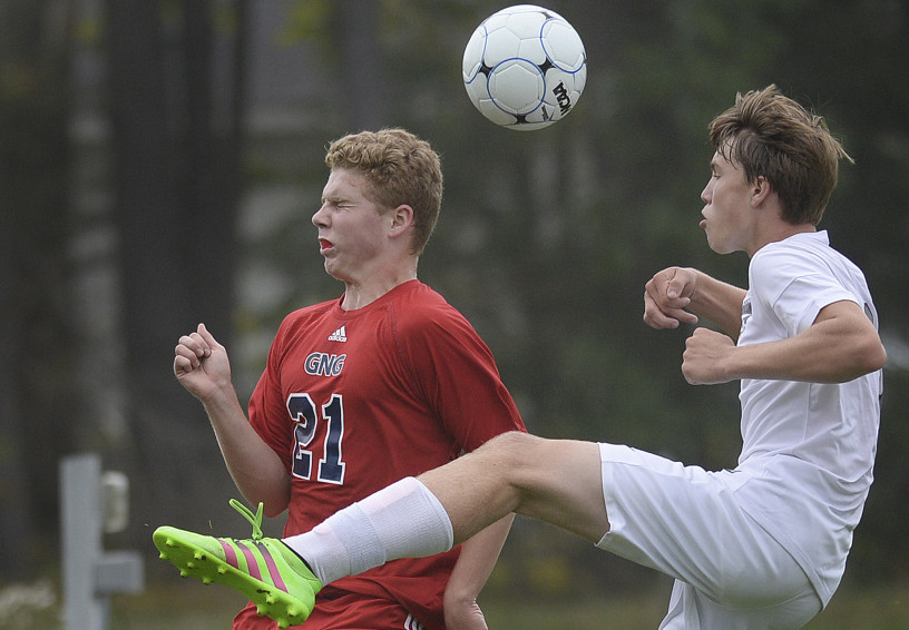 John Martin of Gray-New Gloucester, left, heads the ball away from Shea Wagner of Freeport during Gray-New Gloucester's 1-0 victory Tuesday. The Patriots remained undefeated at 5-0-1.