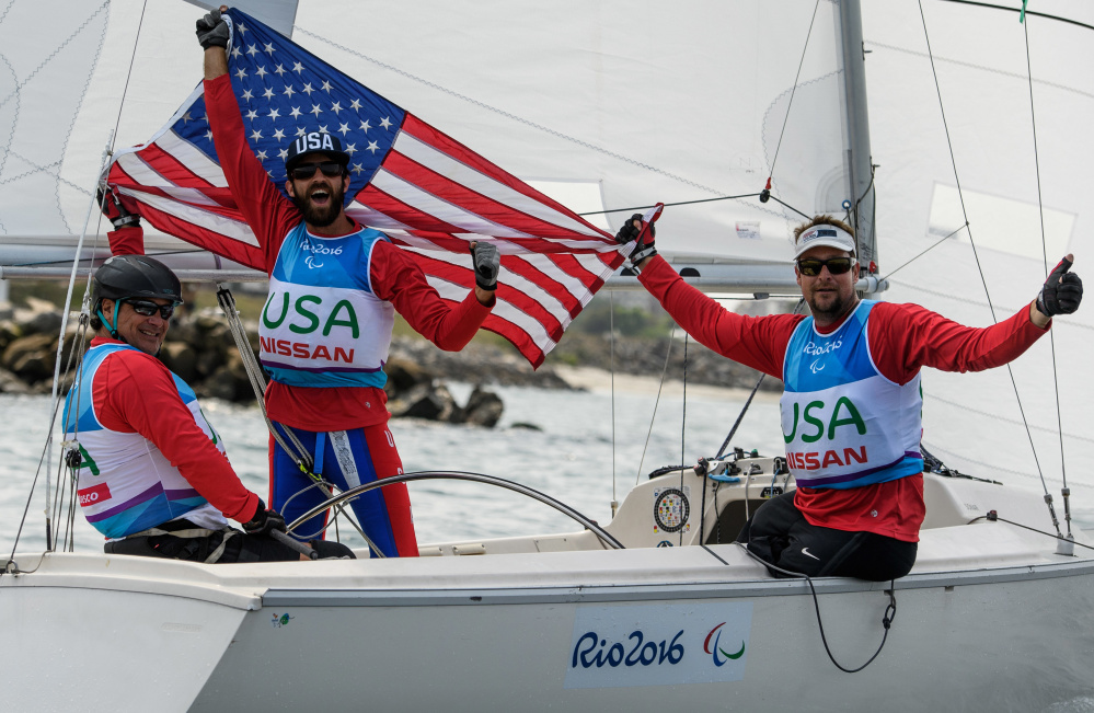 Paralympics silver medalists Hugh Freund of South Freeport, center, with Rick Doerr of New Jersey, left, and Brad Kendell of Florida celebrate in their 23-foot, 3-person keelboat at Marina da Gloria in Rio de Janeiro, Brazil, on Saturday.