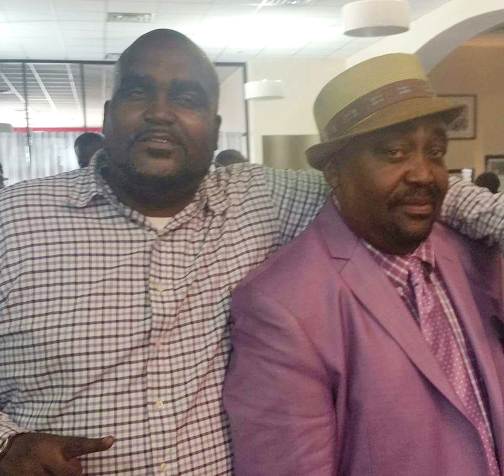 Terence Crutcher, left, shown with his father, Joey Crutcher, was killed by an Oklahoma police officer Friday after Crutcher's vehicle stalled. He was unarmed.