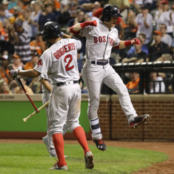 Andrew Benintendi, right, celebrates his three-run home run with teammate Xander Bogaerts in the sixth inning Wednesday night for the Red Sox in Baltimore.