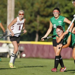 Joanna LaFrance of Massabesic sends the ball forward in the second half Wednesday for Massabesic, which scored a late goal to remain undefeated with a 2-2 tie against Gorham in field hockey.