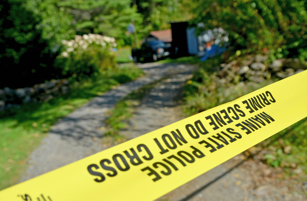 Police tape marks off the driveway to the Tieman residence at 628 Norridgewock Road in Fairfield on Tuesday after Valerie Tieman's body was discovered buried on the property. An autopsy by the state Medical Examiner's Office this week determined the cause of death was two gunshot wounds to the head.