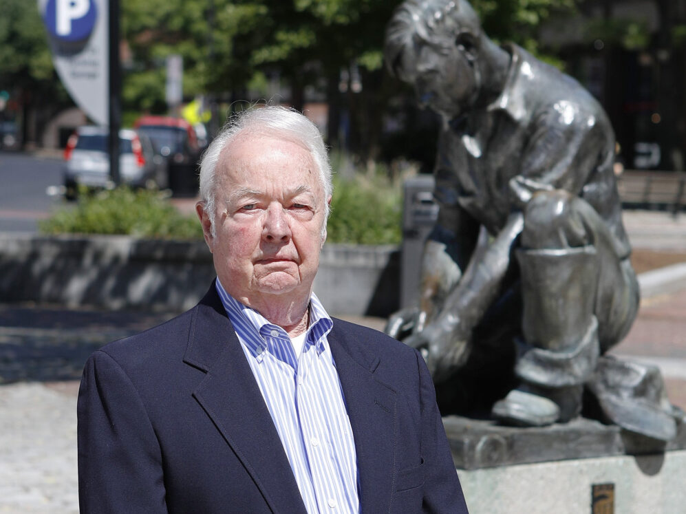 Former Portland City Manager John Menario poses for a photo in 2016, when the plaza next to the Temple Street parking garage was renamed John Menario Plaza. He died Thursday at 83.