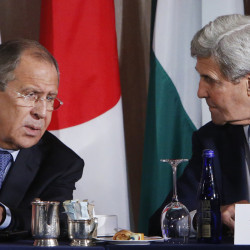 Russian Foreign Minister Sergey Lavrov and United States Secretary of State John Kerry talk during a meeting of the International Syria Support Group on Thursday in New York.