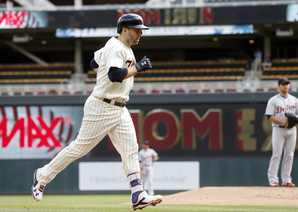 Minnesota's Brian Dozier jogs home after his 42nd home run, a solo shot off Detroit's Anibal Sanchez, right, in the first inning of the Twins' 9-2 loss to the Tigers on Thursday in Minnesota.