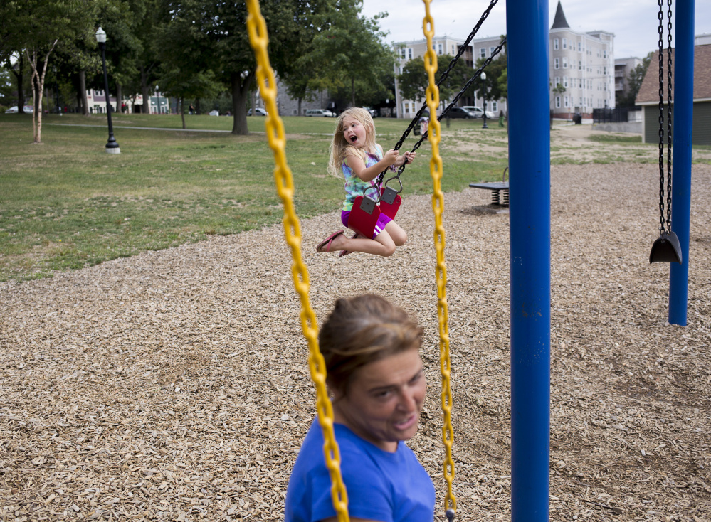 Arianna plays for hours at Kennedy Park in Lewiston while her mother and Troy wait to hear if they will be able to move into the apartment in Auburn.