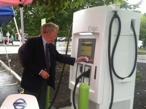 Sen. Angus King charges a Nissan Leaf at a new fast charge station in Portland on Friday.