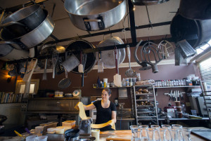 Brianne Shea, a prep cook at The Corner Room, prepares fresh lasagna noodles. Many of the restaurant's pastas are made in house.