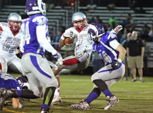 Artimus Stilley of South Portland tries to avoid Aryz Terlaje of Deering as he fights for extra yards in the third quarter Friday night in Portland.